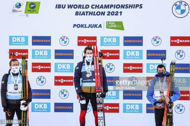 Gold medallist Norway's Sturla Holm Laegreid , silver medallist Norway's Johannes Dale and bronze medallist France's Quentin Fillon Maillet pose on...