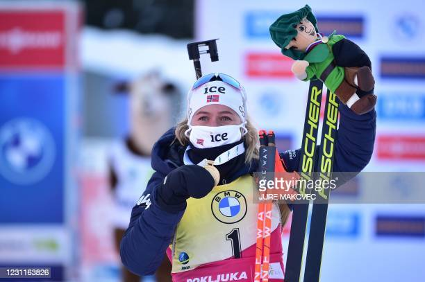 Gold medallist Norway's Tiril Eckhoff poses with her medal after the Women's 10 km Pursuit event at the IBU Biathlon World Championships in Pokljuka,...
