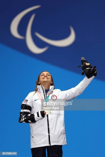 Gold Medallist Oksana Masters of the United States celebrates at the medal ceremony for the Cross Country Women's 5km Sitting on day eight of the...