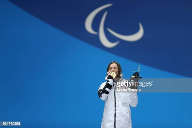 Gold medallist Oksana Masters of USA celebrates during the medal ceremony for the Women's Cross Country 11km Sprint Final Sitting during the medal...