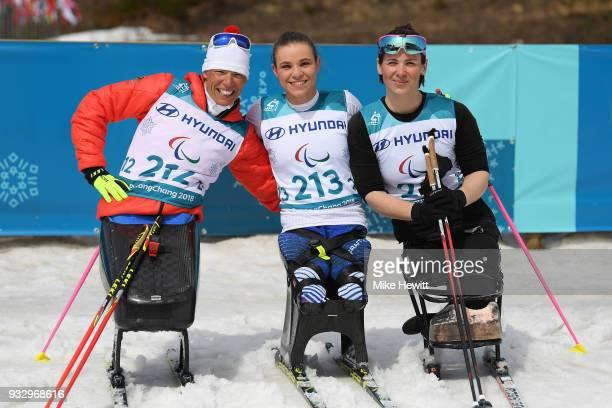 Gold medallist Oksana Masters of USA Silver medallist Andrea Eskau of Germany and Bronze medallist Marta Zainullina celebrate during the ceremony for...