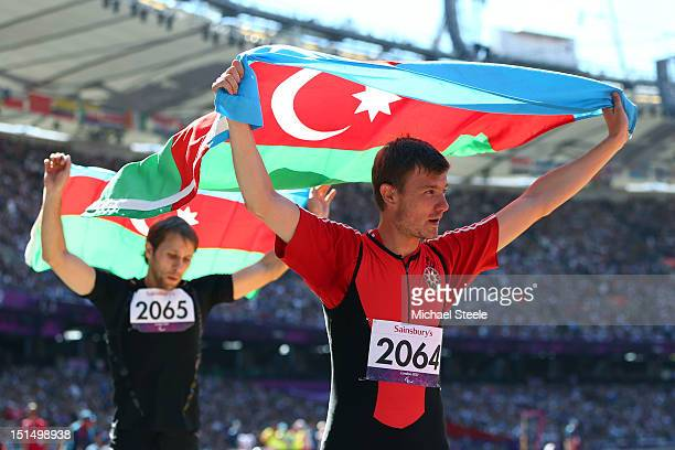 Gold Medallist Oleg Panyutin and silver medalist Vladimir Zayets of Azerbaijan celebrates following the Men's Triple Jump — F12 final on day 10 of...