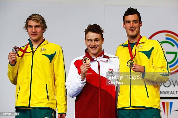 Gold medallist Oliver Hynd of England poses with silver medallist Jesse Aungles of Australia and bronze medallist Blake Cochrane of Australia during...