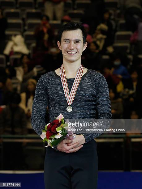 Gold medallist Patrick Chan of Canada stands on the podium of the Men's Figure Skating on day four of the ISU Four Continents Figure Skating...