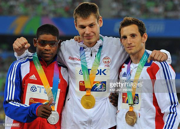 Gold medallist Pawel Wojciechowski of Poland poses with silver medallist Lazaro Borges of Cuba and Renaud Lavillenie of France during the award...