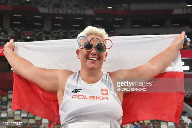 Gold medallist Poland's Anita Wlodarczyk celebrates after the women's hammer throw final during the Tokyo 2020 Olympic Games at the Olympic Stadium...