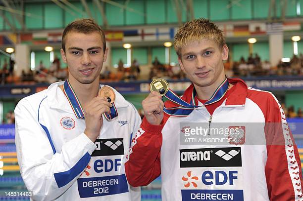 Gold medallist Poland's Radoslaw Kawecki and bronze medallist Israel's Yakov Yan Toumarkin pose on the podium after they competed in the final of the...