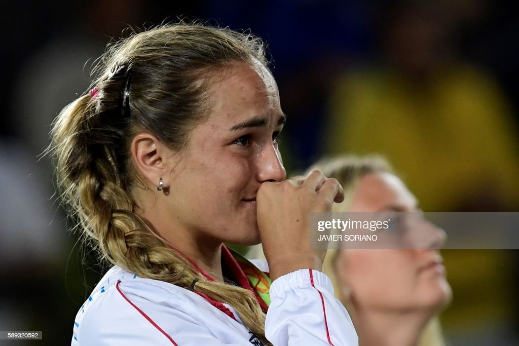 TOPSHOT - Gold medallist Puerto Rico's Monica Puig reacts during the podium ceremony of the women's singles tennis event at the Olympic Tennis Centre of the Rio 2016 Olympic Games in Rio de Janeiro on August 13, 2016. /