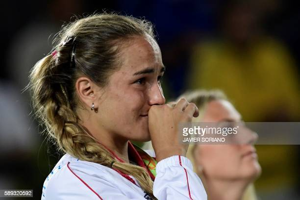 Gold medallist Puerto Rico's Monica Puig reacts during the podium ceremony of the women's singles tennis event at the Olympic Tennis Centre of the...
