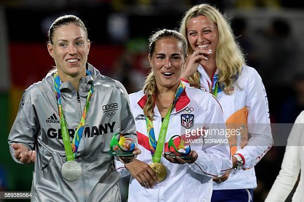 Gold medallist Puerto Rico's Monica Puig , silver medallist Germany's Angelique Kerber and bronze medallist Czech Republic's Petra Kvitova react...