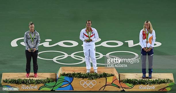 Gold medallist Puerto Rico's Monica Puig , silver medallist Germany's Angelique Kerber and bronze medallist Czech Republic's Petra Kvitova pose on...