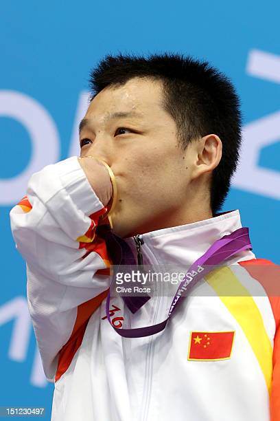 Gold medallist Qing Xu of China poses on the podium during the medal ceremony for the Men's 50m Freestyle S6 final on day 6 of the London 2012...