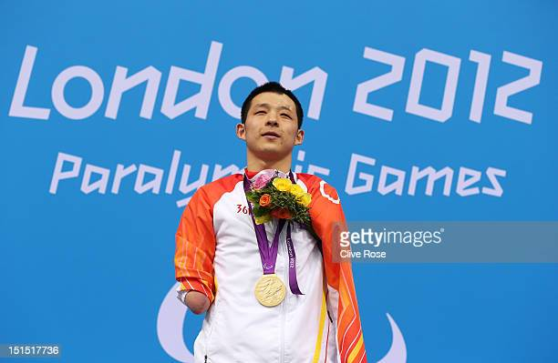 Gold medallist Qing Xu of China poses on the podium during the medal ceremony for the Men's 100m Freestyle S6 final on day 10 of the London 2012...