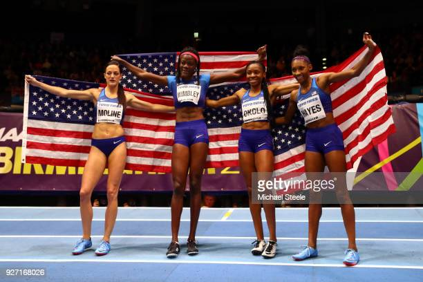 Gold Medallist Quanera Hayes Georganne Moline Shakima Wimbley And Courtney Okolo Of United States celebrate after winning the Women's 4 x 400 Metres...