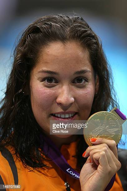 Gold medallist Ranomi Kromowidjojo of the Netherlands poses with the medal won in the Women's 100m Freestyle Final on Day 6 of the London 2012...