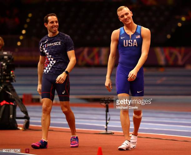 Gold Medallist Renaud Lavillenie of France celebrates winning the Men's Pole Vault Final with Silver Medallist Sam Kendricks of United States during...