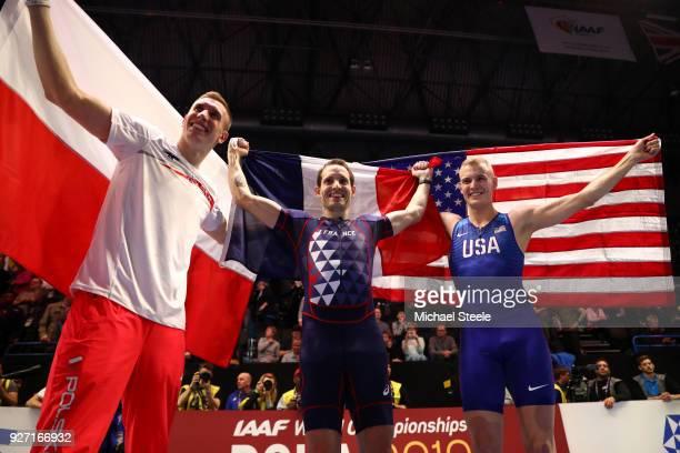 Gold Medallist Renaud Lavillenie of France Silver Medallist Sam Kendricks of United States and Bronze Medallist Piotr Lisek of Poland celebrate after...