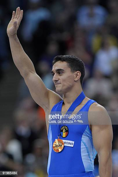 Gold medallist Romania's Marian Dragulescu celebrates after winning the men's floor event in the apparatus finals during the Artistic Gymnastics...