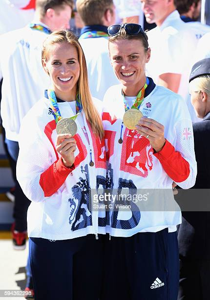 Gold medallist rowers Helen Glover and Heather Stanning pose after arriving home at Heathrow Airport on August 23 2016 in London England The 2016...