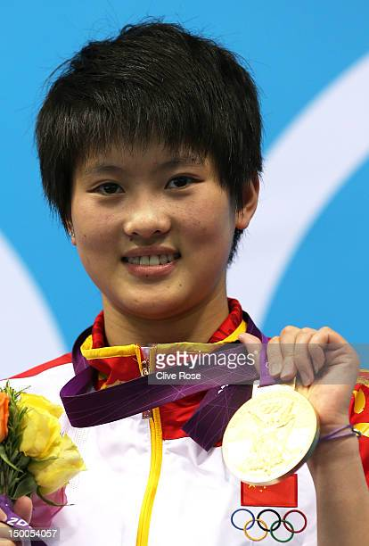 Gold medallist Ruolin Chen of China poses on the podium during the medal ceremony for the Women's 10m Platform Diving Final on Day 13 of the London...