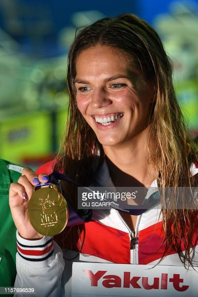 Gold medallist Russia's Yuliya Efimova poses after the final of the women's 200m breaststroke event during the swimming competition at the 2019 World...