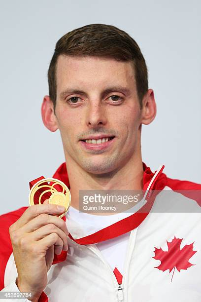 Gold medallist Ryan Cochrane of Canada poses during the medal ceremony for the Men's 1500m Freestyle Final at Tollcross International Swimming Centre...