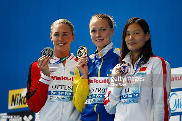 Gold medallist Sarah Sjostrom of Sweden poses with silver medallist Jeanette Ottesen of Denmark and bronze medallist Ying Lu of China during the...