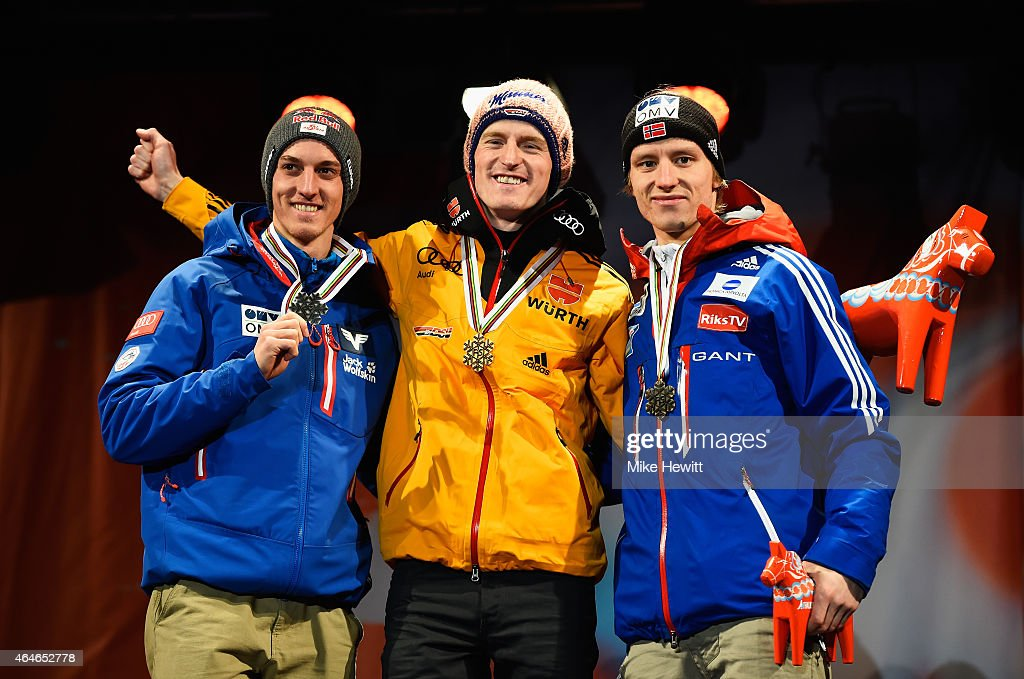 Gold medallist Severin Freund of Germany poses with silver medallist Gregor Schlierenzauer of Austria (L) and bronze medallist Rune Velta of Norway during the medal ceremony for the Men's HS134 Large Hill Ski Jumping Final during the FIS Nordic World Ski Championships at the Lugnet venue on February 27, 2015 in Falun, Sweden.