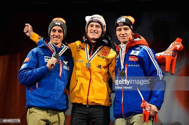Gold medallist Severin Freund of Germany poses with silver medallist Gregor Schlierenzauer of Austria and bronze medallist Rune Velta of Norway...