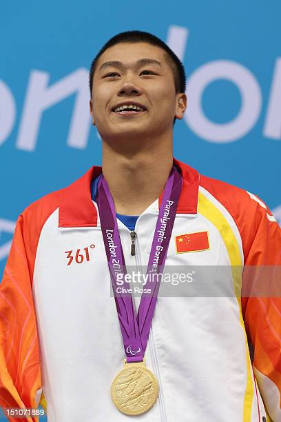 Gold medallist Shiyun Pan of China poses on the podium during the medal ceremony for the Men's 50m Butterfly S7 Finalon day 2 of the London 2012...