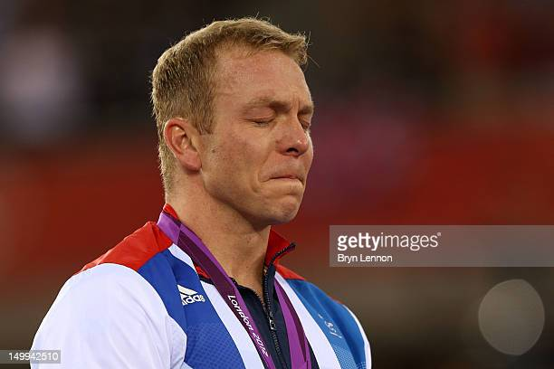 Gold medallist Sir Chris Hoy of Great Britain cries as he celebrates during the medal ceremony for the Men's Keirin Track Cycling Final on Day 11 of...