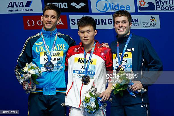 Gold medallist Siyi Xie of China poses with silver medallist Illya Kvasha of Ukraine and bronze medallist Mike Hixon of the United States during the...