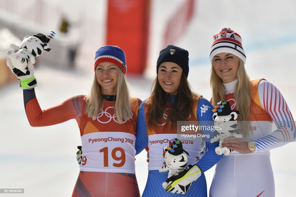 Gold medallist Sofia Goggia, center, of Italy celebrates with silver medallist Ragnhild Mowinckel, left, of Norway and bronze medallist Lindsey Vonn of the United States during the victory ceremony for the Ladies' Downhill on day 12 of the PyeongChang 2018 Winter Olympic Games at Jeongseon Alpine Centre February 21, 2018