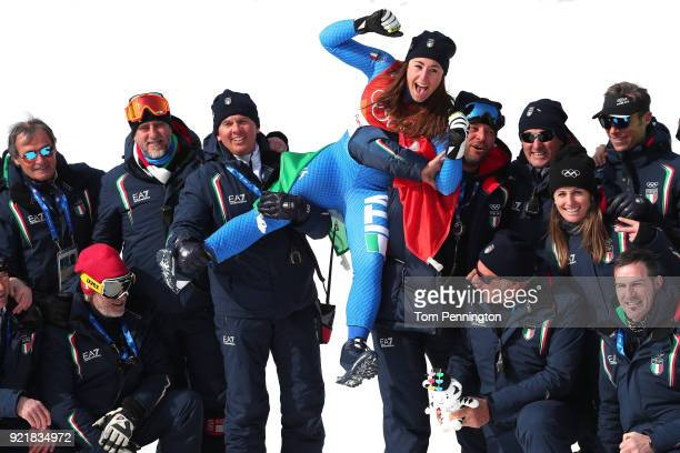 Gold medallist Sofia Goggia of Italy celebrates with her team during the victory ceremony for the Ladies' Downhill on day 12 of the PyeongChang 2018...