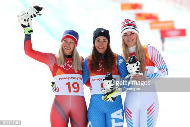 Gold medallist Sofia Goggia of Italy celebrates with silver medallist Ragnhild Mowinckel of Norway and bronze medallist Lindsey Vonn of the United...