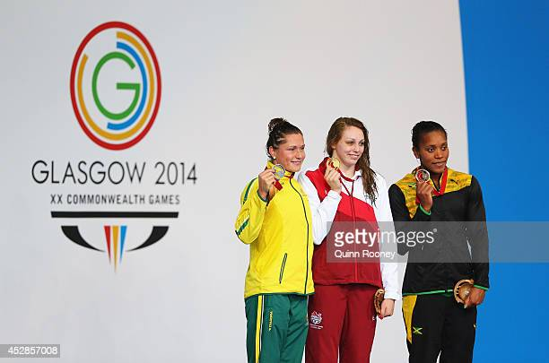 Gold medallist Sophie Taylor of England poses with silver medallist Lorna Tonks of Australia and bronze medallist Alia Atkinson of Jamaica during the...