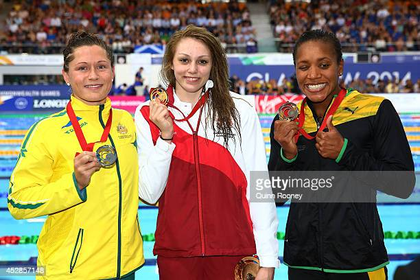 Gold medallist Sophie Taylor of England poses with silver medallist Lorna Tonks of Australia and bronze medallist Alia Atkinson of Jamaica after the...
