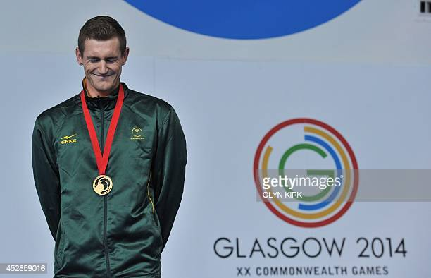 Gold medallist South Africa's Cameron van der Burgh poses on the podium during the Men's 50m Breaststroke medal ceremony at the Tollcross...