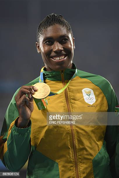 Gold medallist South Africa's Caster Semenya poses on the podium for the Women's 800m Final during the athletics event at the Rio 2016 Olympic Games...