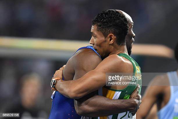 Gold medallist South Africa's Wayde van Niekerk hugs USA's Lashawn Merritt after the Men's 400m Final during the athletics event at the Rio 2016...