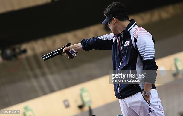 Gold medallist South Korean Jin Jongoh competes in the 10m Air Rifle men's final at the Royal Artillery Barracks in London on July 28 during The...