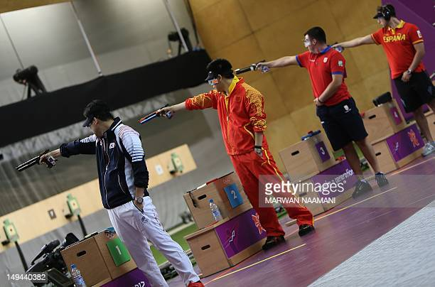 Gold medallist South Korean Jin Jongoh silver medallist Pang Wei of China bronze medalist Andrija Zlatic of Serbia and Pablo Carrera of Spain compete...