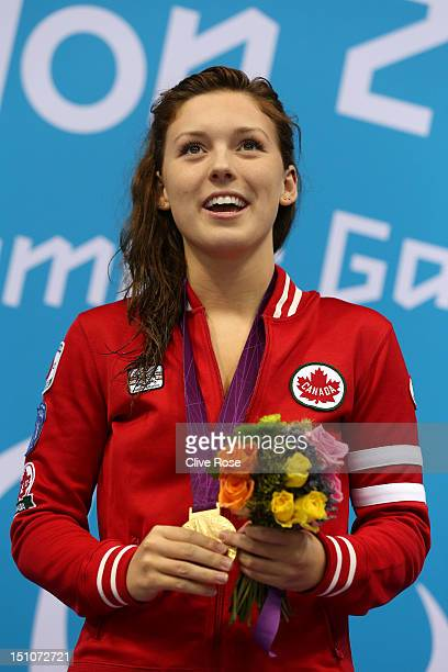 Gold medallist Summer Ashley Mortimer of Canada poses on the podium during the medal ceremony for the Women's 50m Freestyle S10 Final on day 2 of the...