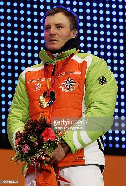 Gold medallist Sven Fischer of Germany waves during the medal ceremony for the Men's Biathlon 10km Sprint Final on Day 4 of the 2006 Turin Winter...