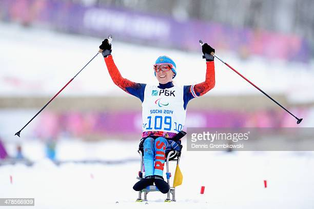 Gold medallist Svetlana Konovalova of Russia celebrates at the finish line after winning gold medal in the Women's 125km sitting biathlon during day...