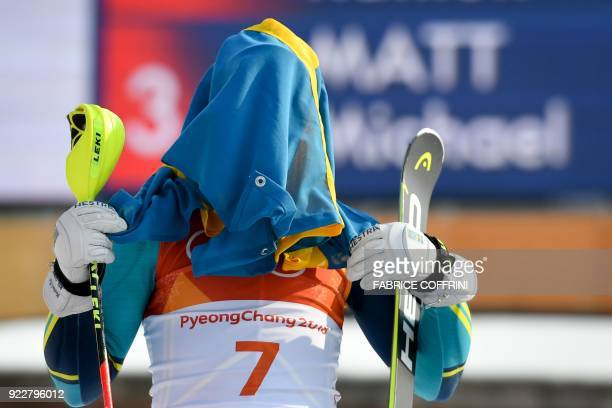 TOPSHOT Gold medallist Sweden's Andre Myhrer covers his face with his national flag as he celebrates on the podium during the victory ceremony in the...