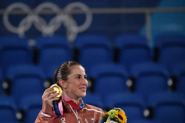 Gold medallist Switzerland's Belinda Bencic poses with her medal during the Tokyo 2020 Olympic Games women's singles tennis medal ceremony at the...
