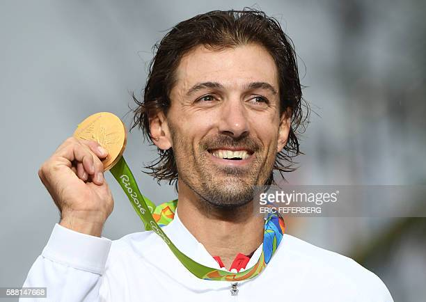 Gold medallist Switzerland's Fabian Cancellara poses on the podium after the Men's Individual Time Trial event at the Rio 2016 Olympic Games in Rio...