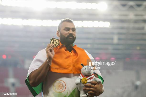 Gold medallist Tajinderpal Singh Toor of India pose for photo during Athletics Men's Shot put medal ceremony on day seven of the Asian Games on...