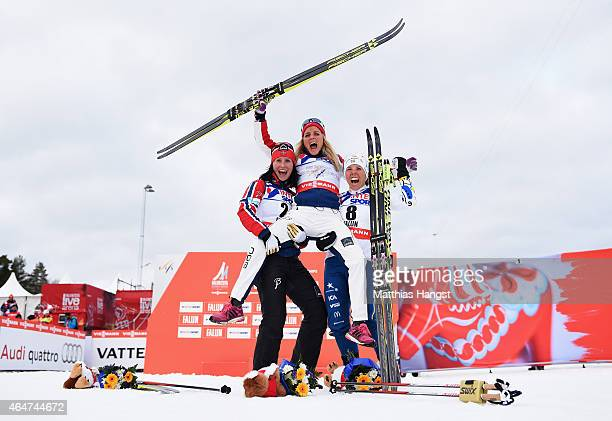 Gold medallist Therese Johaug of Norway celebrates with silver medallist Marit Bjoergen of Norway and bronze medallist Charlotte Kalla of Sweden...